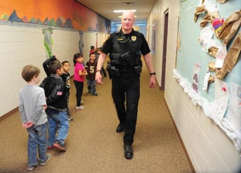 cop in school